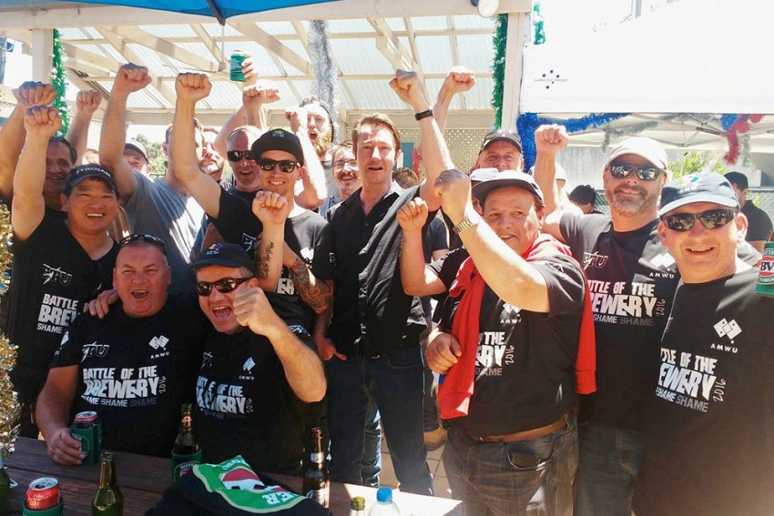 Carlton United Breweries workers celebrate their victory