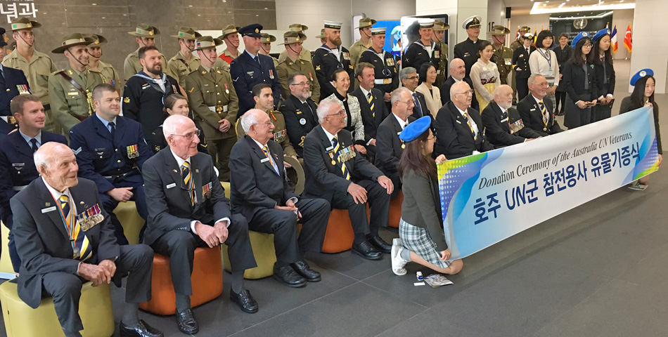 Veterans with Minister Tehan and UN Peace Memorial Hall Director Jun Oi-Sook