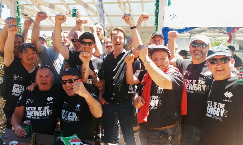 Carlton United Breweries workers celebrate their victory