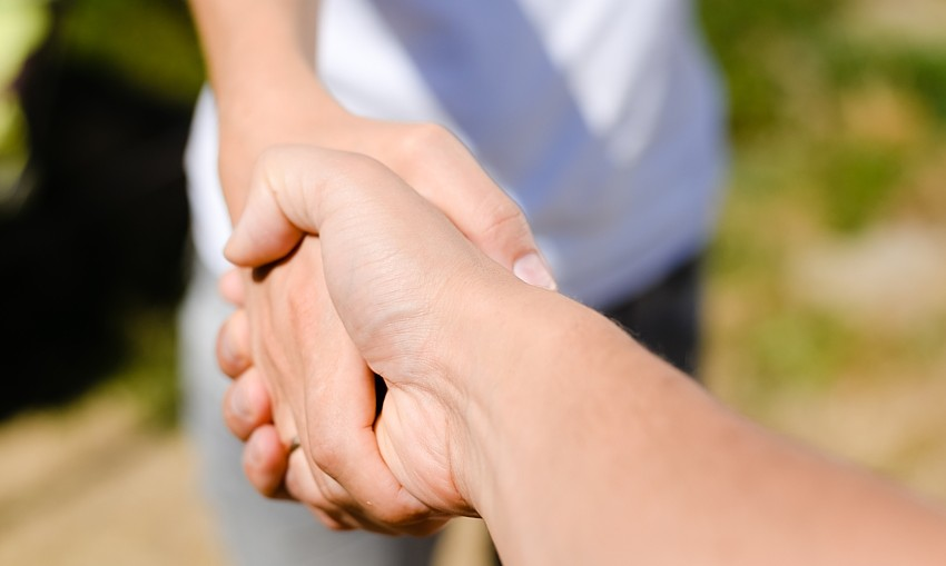handshake-rural-by-Ligorosi-dreamstime-Mar2020